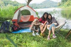Friendship Hangout Traveling Destination. People Friendship Hangout Traveling Destination Camping Concept near lake Stock Photo