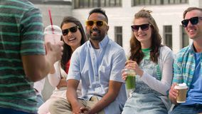 Happy friends drinking coffee and shakes in city stock footage