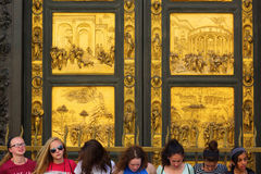 People in front of the Baptistery portal in Florence, Italy Royalty Free Stock Photo