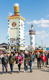 People in front of beer tents at Oktoberfest. MUNICH, GERMANY - SEPTEMBER 30: People in front of the beer tents on the Oktoberfest in Munich, Germany on royalty free stock photo