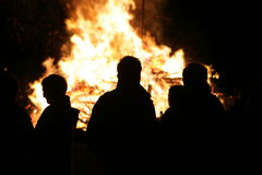 People in front burning woodpile german tradition Royalty Free Stock Photography
