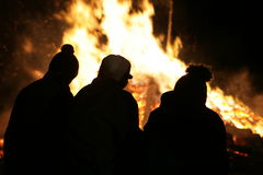 People in front burning woodpile german tradition Stock Photography