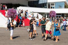 People in front of the Cannes Film Festival theatre Royalty Free Stock Photo