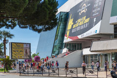 People in front of the Cannes Film Festival theatre Royalty Free Stock Photography
