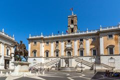 People in front of Capitoline Museums in city of Rome, Italy. ROME, ITALY - JUNE 23, 2017: People in front of Capitoline Museums in city of Rome, Italy Royalty Free Stock Image