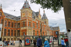 People in front of the Central Station building in Amsterdam, Ne Royalty Free Stock Image
