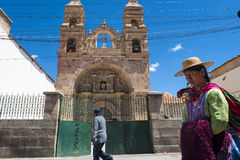 People in front of a church in the city of Potosi in Bolivia. Royalty Free Stock Images