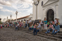 People in front of church in Giron Colombia. July 23, 2017 Giron, Santander: people relax in the historic town centre in the front of the cathedral on a Sunday Royalty Free Stock Photos