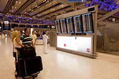 People in front of departures board of airport Royalty Free Stock Images