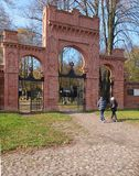 The gate of the Kirkut. People in front of the entrance gate of the historic Jewish cemetery in Lodz Royalty Free Stock Photography