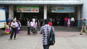 People in front of the entrance to the train station office in Mumbai. stock video footage