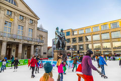 People in front of Goethe and SChiller monument enjoy ice skating Royalty Free Stock Photo