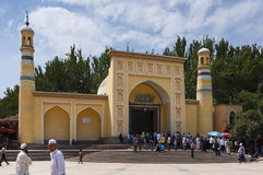 People in front of the Id Kah Mosque in the city of Kashgar in China royalty free stock photography