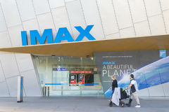 People in front of the IMAX theatre in Melbourne. Melbourne, Australia - July 9, 2016: View of people in front of the IMAX theatre during daytime. IMAX Melbourne Royalty Free Stock Images