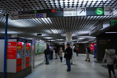 People in front of information signs in Munich Subway. People stand in front of maps of lines and tickets machines at the entrance to a Suburban Railway in Royalty Free Stock Photos