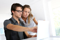 People in front of laptop in office royalty free stock photos