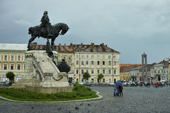 People in Front of Mathias Rex Statue on a Rainy Day Stock Photo