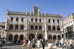 Lisbon Rossio Railway Station. People in front of the Neo-Manueline style facade of Rossio railway station in the historice centre of Lisbon, Portugal Royalty Free Stock Image