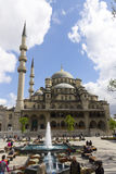 People in front of the New Valide Sultan Mosque on a sunny day Royalty Free Stock Images