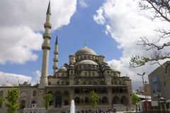 People in front of the New Valide Sultan Mosque on a sunny day Royalty Free Stock Image