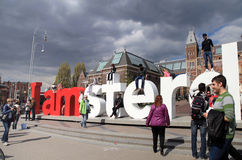 People in front of the Rijksmuseum and popular statue 'I Amsterd Stock Images