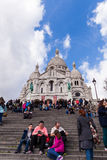 People in front of Sacre Coeur, Famous Church Landmark in Paris France Stock Images