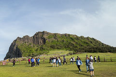 People in front of Seongsan Ilchulbong on Jeju Island Stock Image