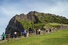 People in front of Seongsan Ilchulbong on Jeju Island Royalty Free Stock Image
