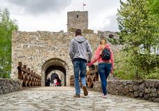 People in front of Strecno castle, Slovakia. STRECNO, SLOVAKIA - MAY 1: Visitors in front of  castle Strecno on May 1, 2019 in Strecno royalty free stock photos