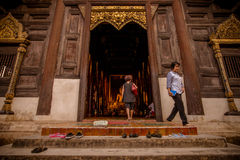 People in front of temple door Royalty Free Stock Photography