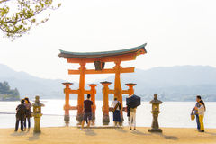 People in front of the torii in Miyajima island, Japan Stock Images