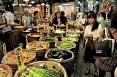 Kyoto shopping center. People in front of a vegetable food store in a Kyoto shopping mall stock images