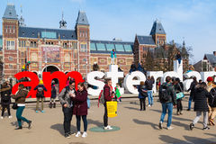 People in front of writing, I amsterdam, Museumplein, Rijksmuseum, Holland Royalty Free Stock Image