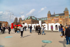 People in front of writing, I amsterdam, Museumplein, Rijksmuseum, Holland Stock Photo