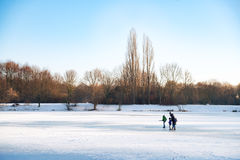 People on a frozen lake. In winter Stock Photo