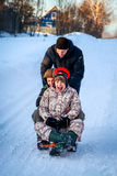 People fun sledding. People fun laughing  sledding outdoor Royalty Free Stock Images