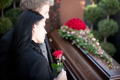 People at Funeral with coffin. Religion, death and dolor  - funeral and cemetery; funeral with coffin Stock Photo