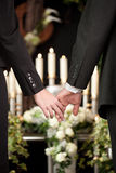People at funeral consoling each other. Religion, death and dolor  - couple at funeral holding hands consoling each other in view of the loss Stock Images