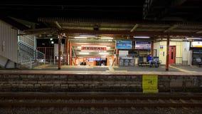 People in Fushimi Inari JR station platform, Kyoto Stock Photo