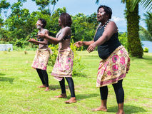 People in GABON. FRANCEVILLE, GABON - MARCH 6, 2013: Unidentified Gabonese peoplel in white paste dance traditional dance in Gabon, Mar 6, 2013. Music is an Stock Photos