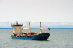 People in GABON. LIBREVILLE, GABON - MAR 6, 2013: Cargo ship near the port of Libreville. Port of Libreville is a trade center for a timber region Stock Photo