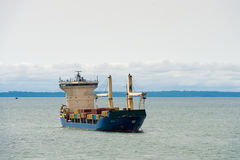 People in GABON. LIBREVILLE, GABON - MAR 6, 2013: Cargo ship near the port of Libreville. Port of Libreville is a trade center for a timber region Royalty Free Stock Photos