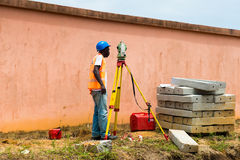 People in GABON. GABON - MARCH 6, 2013: Unidentified Gabonese man works as a constuctor in Gabon, Mar 6, 2013. People of Gabon suffer of poverty due to the Stock Photo