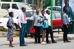 People in GABON. GABON - MARCH 6, 2013: Unidentified Gabonese people waiting for a bus on a bus stop in Gabon, Mar 6, 2013. People of Gabon suffer of poverty due Royalty Free Stock Image
