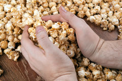 People gaining a bunch of popcorn. Close up stock photography
