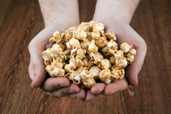 People gaining a bunch of popcorn. Close up stock images