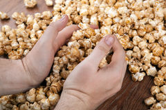 People gaining a bunch of popcorn. Close up stock photos