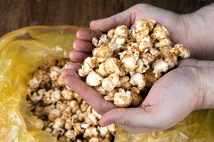 People gaining a bunch of popcorn from the package. Close up stock images