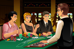 People Gambling in a Casino Stock Image