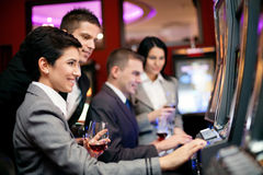 People gambling on slot machines Royalty Free Stock Photography